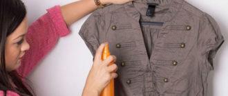 Девушка брызгает блузу кондиционером для белья