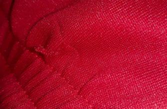 Затяжка на красном свитере
