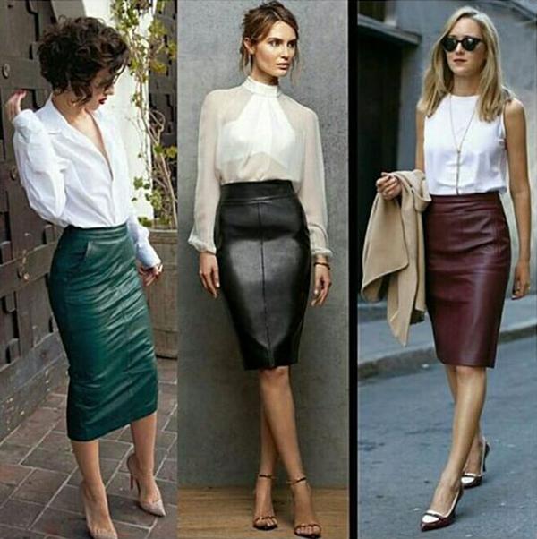Девушки в белых блузках и кожаных юбках миди
